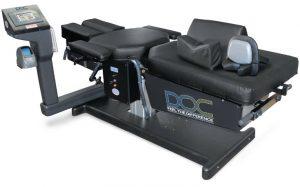 Θεραπεία στη μέση με το μηχάνημα της αποσυμπίεσης